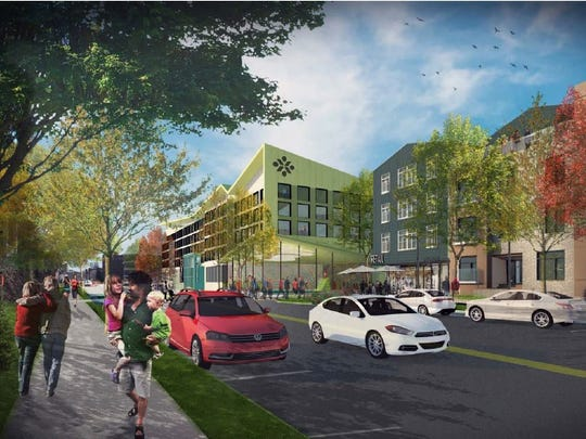 """A Strong National Museum of Play expansion to include a 120-room hotel with an indoor water feature as part of its pool and spa, 201 units of housing, """"urban retail spaces"""" and a 1,200-space parking garage, all extending from Broad Street south. This is one of the views down South Union Street."""