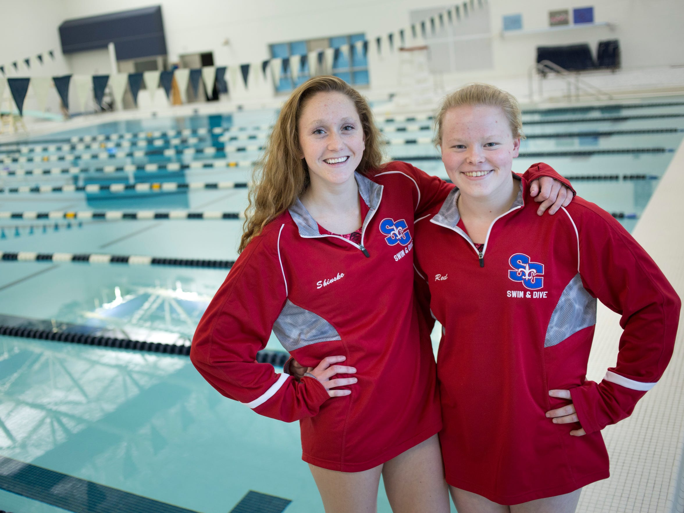 St. Clair senior Grace Shinske and Alexis Smith pose before practice Wednesday, November 18, 2015 in Marysville. The team will be competing in a state meet this weekend.