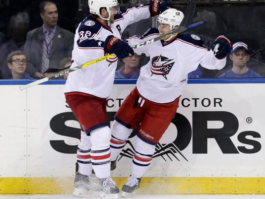 Columbus Blue Jackets' Cam Atkinson, right, celebrates with Boone Jenner after scoring during the third period of the NHL hockey game, Sunday, Feb. 26, 2017, in New York. The Blue Jackets defeated the Rangers 5-2. (AP Photo/Seth Wenig)