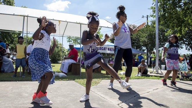 Mahaya Williams, 5, left, Londyn Shirley, 5, Jennifer Dungey and Kalani Dungey, 6, dance during a Juneteenth celebration at Veterans' Memorial Park on May 8, 2019, in Elgin, Texas.