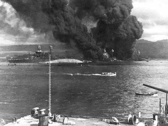 Ships burn after the Japanese attack on Pearl Harbor