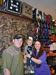 Owners of Gator Archery & Outdoors Jimmy Greer, left,