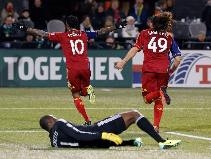 Real Salt Lake forward Robbie Findley (10) celebrates after scoring a goal in the first half during the MLS Western Conference Championship soccer game against the Portland Timbers at Jeld-Wen Field.