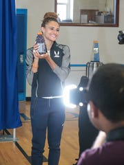 Sydney McLaughlin poses with a bottle of Gatorade that carries her photograph at a press conference at Union Catholic High School on July 20, 2016. McLaughlin is a 16-year-old track and field athlete heading to the Rio games.
