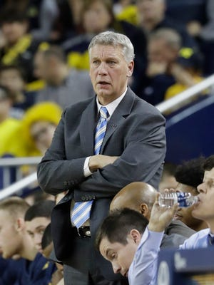 FILE -- Michigan assistant coach Jeff Meyer watches during the second half of an NCAA college basketball game against Furman, Thursday, Dec. 22, 2016, in Ann Arbor, Mich. (AP Photo/Carlos Osorio)