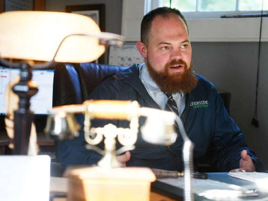 Josh Darty, director of Riverside Cemetery, at his
