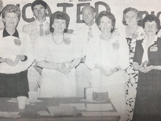 Teachers awarded with the Golden Apple and Perfect Attendance awards in May 1987 were, left to right, John Coble, Pat Maddox, Dana O'Nan, Susan Henning, Norman Hill, Frances Vandiver, Mary Lou Young, Ann Collins, and Shaleen Kramer.