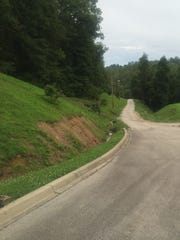 A road leads into the Eastern Kentucky mountains from Chad's Hope addiction recovery center.