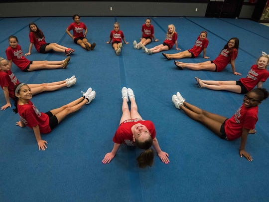 """5/17/17- Jackson NJ, Isabella """"Bella"""" Hope Georgiano , 12 of Jackson  (top facing backward) a member of the Jackson Jaguars Division 12 Large Red Cheer team poses with her team as they form a """"heart""""."""