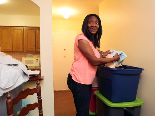 Sheila Vereen-Massengale unpacks her clothing in her new apartment in Ossining, Oct. 28, 2016.