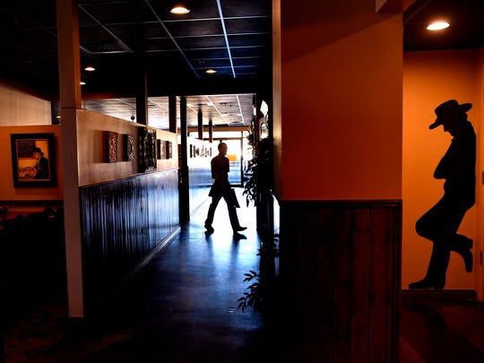 A waiter crosses the hallway Tuesday March 20, 2018 at the Beehive Restaurant & Saloon in Abilene.
