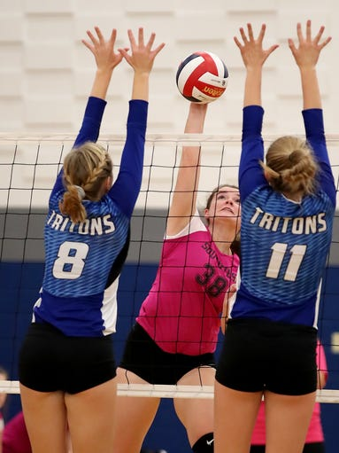 Southwest High School's Eryn Flynn spikes against Notre