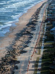 A section of State Road A1A in Flagler County shows erosion damage after Hurricane Matthew passed the east coast of Florida in October 2016. The section of road had been previously undermined, and county officials recently had begun a beach replenishment process.
