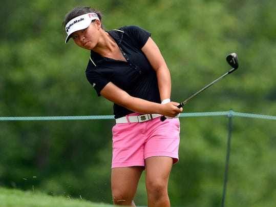 Amateur Megan Khang chips onto No. 9 during the first round of the US Women's Open on Thursday. Khang finished 1-over par after being in the lead at 4 under for several holes.
