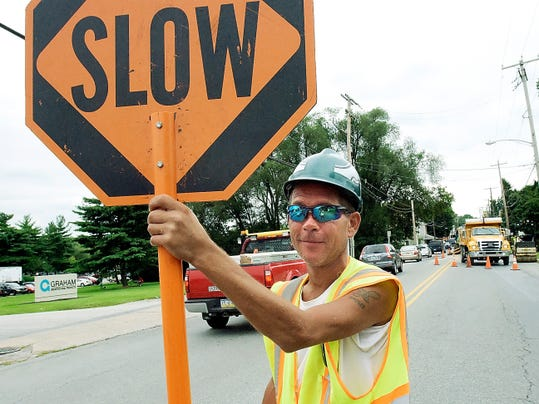Flagger David Reburn of York City works a construction site on Mount Rose Avenue in Spring Garden Township last week.