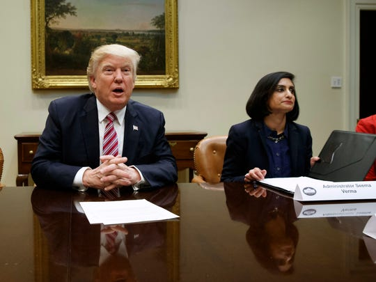 Seema Verma, right, attends a meeting with President