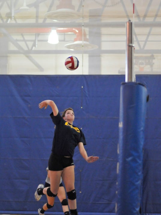 Katie Baynum goes up for a spike during a recent preseason practice.