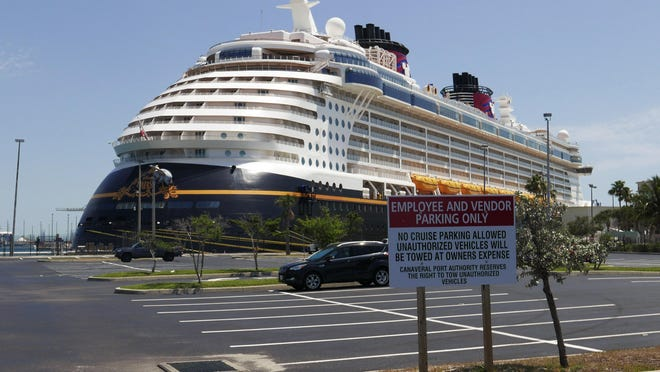 Due to the coronavirus, a Disney cruise ship is docked at Port Canaveral Saturday, April 4, 2020, in Cape Canaveral.