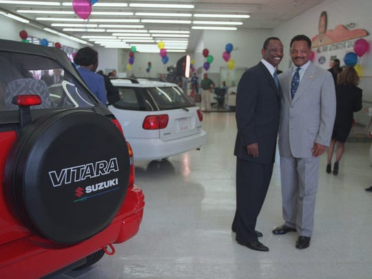 Mel Far and the Rev. Jesse Jackson posed for pictures before the press conference where Farr and the Rev. Jesse Jackson announced Farr's successful completion of a $36 million deal to obtain financial backing. This is dealership was on the northside of 8 Mile Road.