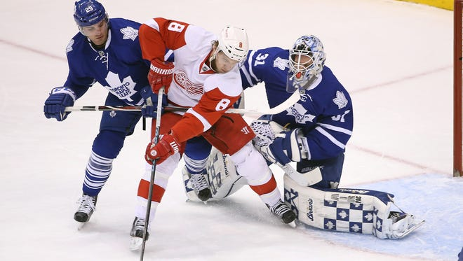 Red Wings left wing Justin Abdelkader (8) gets to a rebound in front of Maple Leafs goalie Garret Sparks (31) Saturday Air Canada Centre.