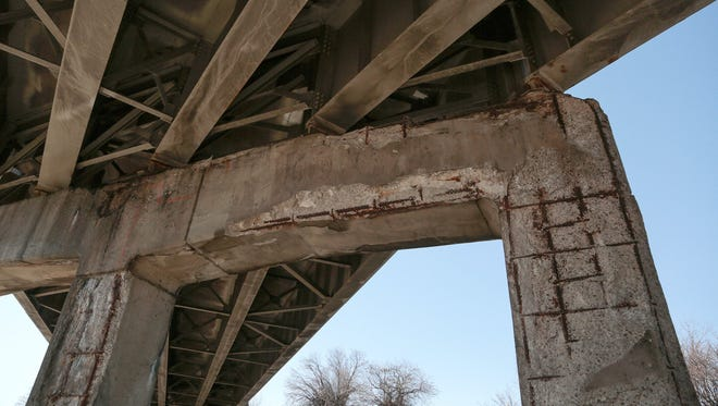 Exposed re-bar on the eastbound I-94 ramp is seen on northbound I-75 in Detroit on Wednesday March 11, 2015.