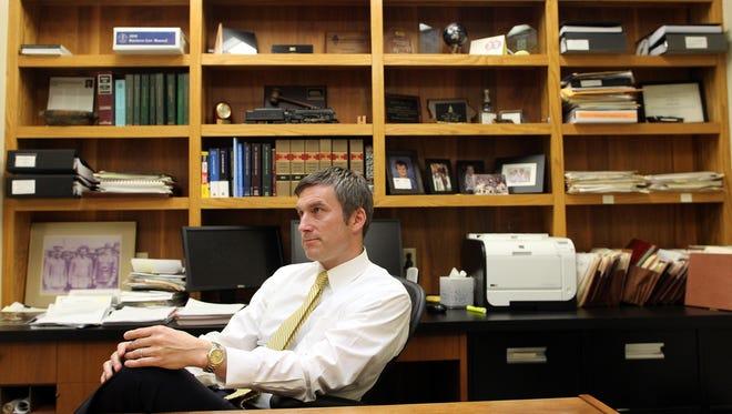 Iowa City Mayor Matt Hayek looks back at his time as mayor on Monday, Dec. 21, 2015.