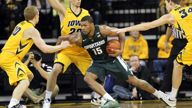 Michigan State's Marvin Clark, Jr. works around Iowa defenders during their game at Carver-Hawkeye Arena on Tuesday, Dec. 29, 2015.