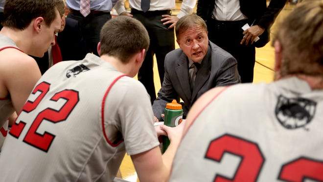 Western Oregon head coach Jim Shaw talks to his team during a timeout in the Western Washington University vs. Western Oregon University men's basketball game at Western Oregon University in Monmouth on Thursday, Feb. 11, 2016. Western Oregon won the game 90-85.