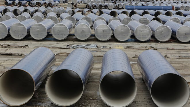 Sections of pipeline are seen in a lot along Stewart Avenue in Flint on Feb. 5, 2016.