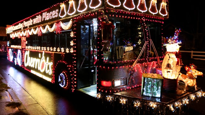 A Cherriots bus is lit up before the start of the 25th annual Festival of Lights Holiday Parade in Keizer on Saturday, Dec. 12, 2015. Organizers of the parade announced their retirement Tuesday, March 1.