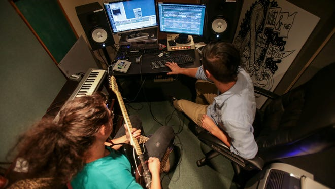 Kim Vi, left, records a collaboration with Producer Nigel Van Hemmye, at Assemble Sound in Detroit, photographed on Monday, Aug.15, 2016.