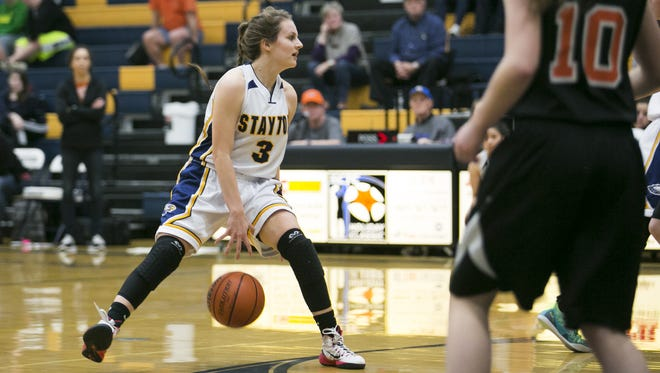Stayton junior Tess Hendricks (3) dribbles the ball in a game against Yamhill-Carlton at Stayton High School on Friday, Feb. 12, 2016. The Stayton Eagles won 48-36 over the Yamhill-Carlton Tigers.