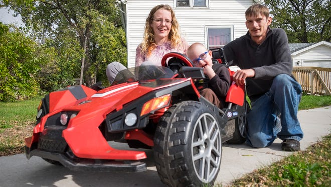 Kathryn and Steven Vancamp with their son, Isaac, 4, on Thursday, Oct. 19, 2017. Isaac has cerebral palsy and uses a modified Polaris Slingshot model to get around. On Sunday, students from local robotics teams build cars for four families affiliated with Michigan Kids on the Move, a non-profit started by the Vancamps.