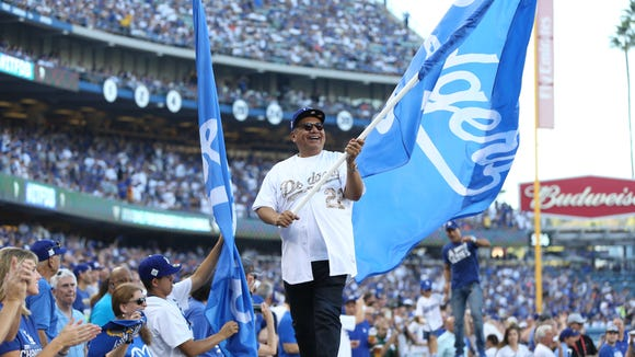 George Lopez waves the flag for the home team, the