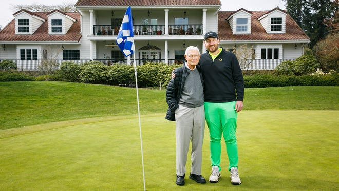 Tom Kay Sr., co-owner of Salem Golf Club, stands with general manager and head pro Alan Reese, right, on the 18th green, on Thursday, April 29, 2018. The Kay family has owned the club since its inception in 1927, and Tom Kay is now 94 years old.