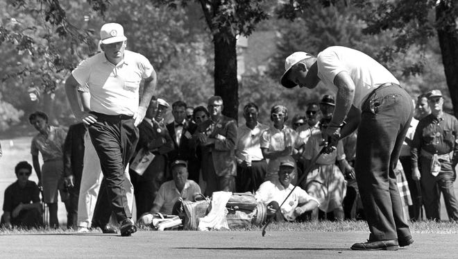 In this 1960 photo, Jack Nicklaus putts to win his U.S. Amateur match against Phil Rodgers.