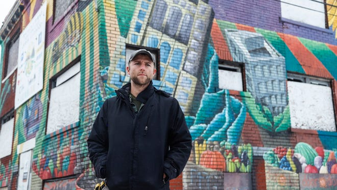 Tyson Gersh in January in front of a building that's part of his Michigan Urban Farming Initiative on Brush Street in Detroit. (Photo taken Jan. 10, 2018)