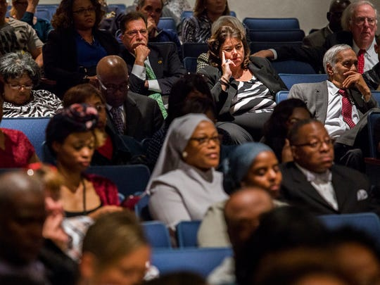 Community members listen as Howard High School of Technology Principal Stanley Spoor speaks at a community town hall meeting on the death of Howard student Amy Inita Joyner-Francis at Stubbs Elementary School on Monday evening.