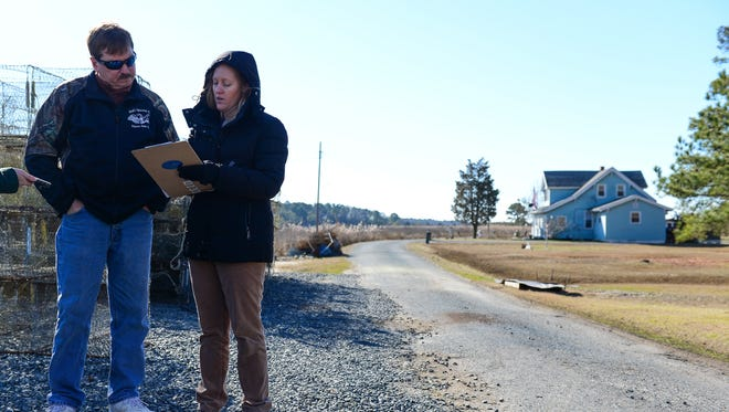 """Roy Ford fills out a survey with University of Maryland researcher Katherine """"Jo"""" Johnson about his property located on the Deal Island Peninsula on Saturday, Feb 4, 2017."""