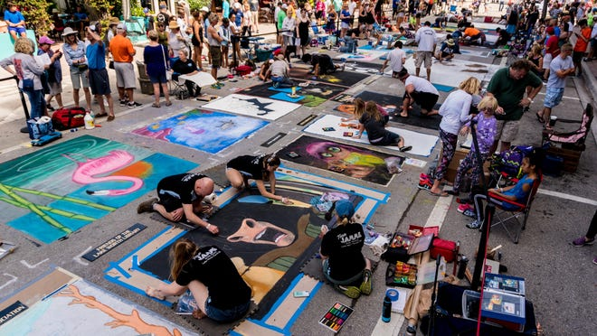 Artists start their pieces along Lucerne Avenue during first day of the 24th annual Street Painting Festival in Lake Worth on February 24, 2018.