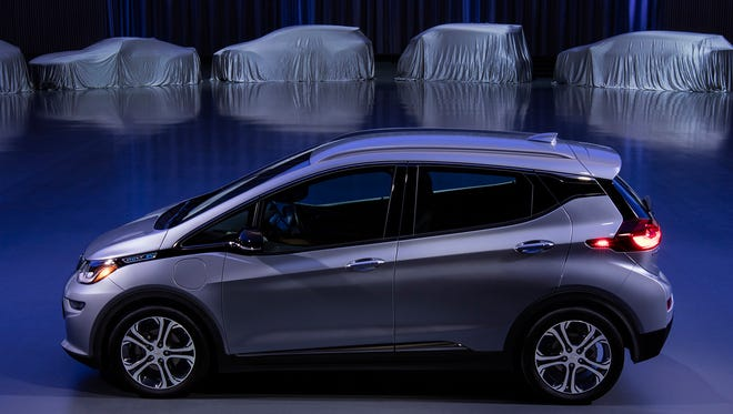 The Chevrolet Bolt Electric Car is posed in front of other as-yet-undisclosed General Motors electric cars at the Design Dome of the GM Warren Tech Center.