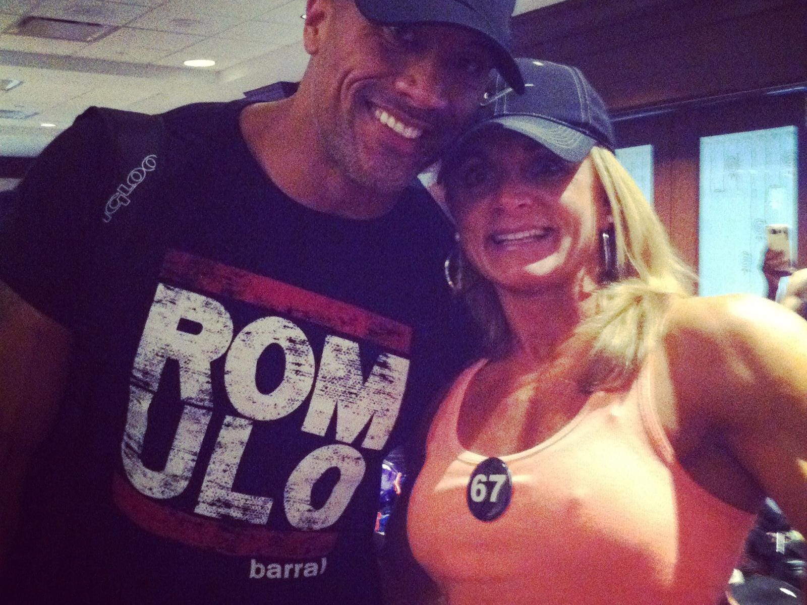 Mo Newman is photographed with Dwayne 'The Rock' Johnson after a show in Pittsburgh in 2014. The parents of Johnson were named the godparents of Mo when she was baptized as an baby.