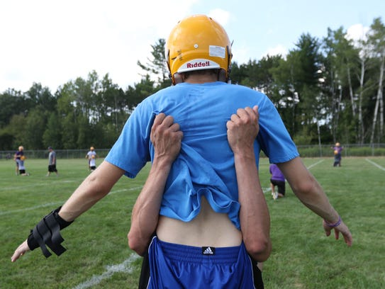 Pittsville High School football players practice low