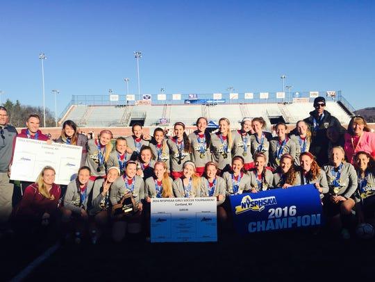 The Arlington girls soccer team celebrates its first