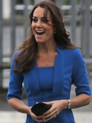 Britain's Duchess of Cambridge, Kate Middleton, arrives to attend the Art Room opening at Northolt High School, in west London, Friday, Feb. 14, 2014.