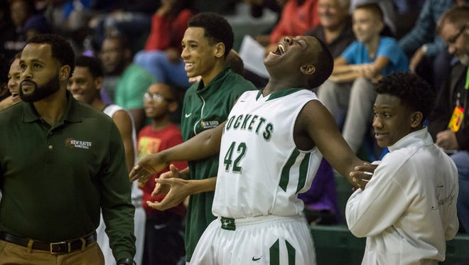 New Haven sophomore Malen Lewis reacts to a dunk on the bench during a basketball game Thursday, Dec. 29, 2016 at New Haven High School.