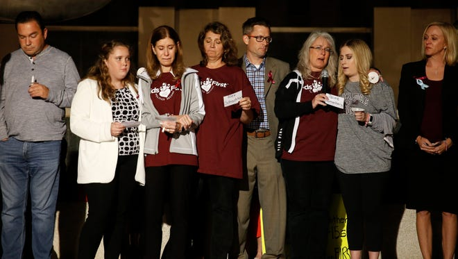 During Tuesday's vigil, Parkland community members, friends and family of victims and survivors of the shooting at Marjory Stoneman Douglas High School read the names of the 17 people who were killed.