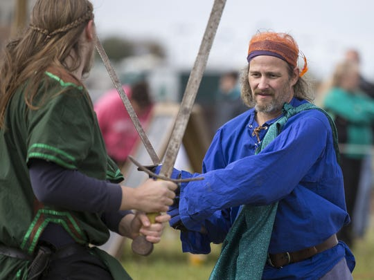 Dan Rose (left), Pleasant Lake, and Duane Walters, Angola, work through sword fighting techniques during the 10th annual Fishers Renaissance Faire, Fishers, Sunday, October 5, 2014.