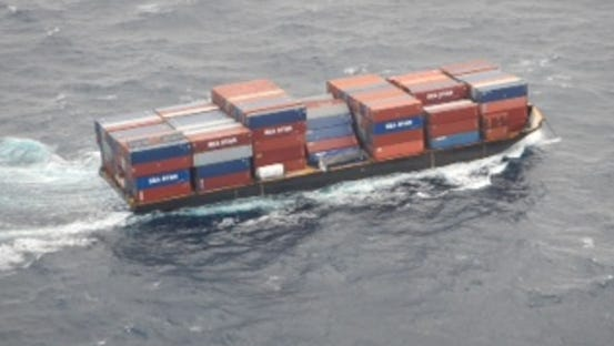 Barge container ship, Columbia Elizabeth, is towed to Port of Palm Beach, Dec. 6, 2015. While enroute to Puerto Rico, several cargo containers fell overboard off the coast of Port Canaveral