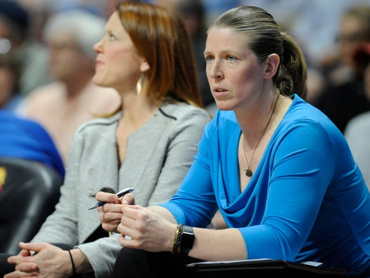 FILE - In this June 16, 2016, file photo, New York Liberty associate head coach Katie Smith watches from the bench during the first half of a WNBA basketball game in Uncasville, Conn. Smith is getting a chance to be a head coach for a game. The Liberty's associate head coach will lead New York on Tuesday night, Sept. 13, 2016, against the Washington Mystics. (AP Photo/Jessica Hill, File)